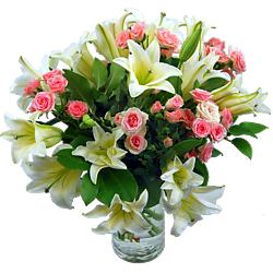 The Sweet Candy Bouquet features spray roses and white lilies